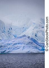 Antarctic Iceberg - Stock Photo of Iceberg from lower...