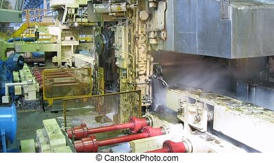Pressing machine works in production shop of rolling mill,...