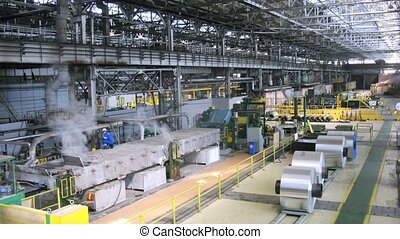 Rolls of aluminum lie in production shop of plant, time lapse