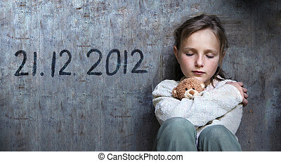 End of the World is coming - Frightened child with date of...