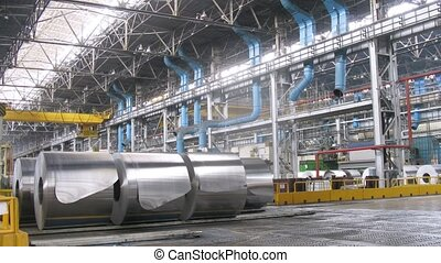 Rolls of aluminum lie in production workshop of plant