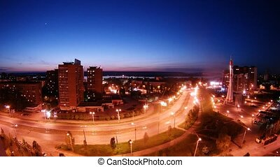 Cars go on street of night Samara near Monument Rocket, time...