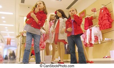 Kids stand near dummies in shopping center with balloons -...