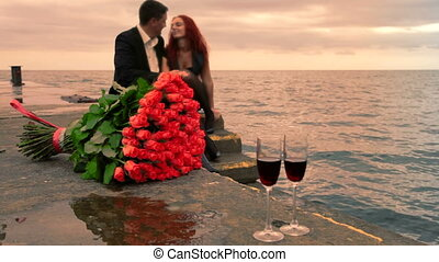 Romance dating by the sea - two glasses of wine and a...