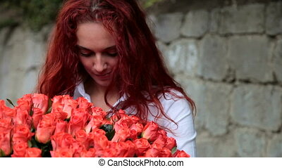 enjoying bunch of fresh flowers - Young woman enjoying bunch...