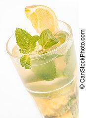 Fresh Orange Mojito cocktail close up - Mojito a Cuban...