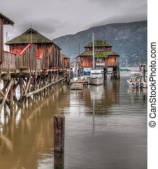 Wooden Buildings Over Water in Marina - In marina with...