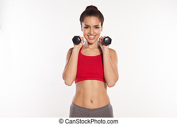 Happy young woman working out with dumbbells