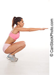 Woman working out doing aerobics crouched down on her...
