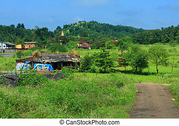 Indian village scene - A beautiful scene of a road leading...