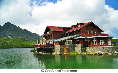 wooden house on glacier lake
