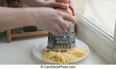 Man grating cheese for pizza