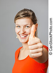 young woman thumb up - An image of a young woman with a...