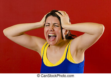 Nervous woman - Angry woman screaming loud , isolated on red