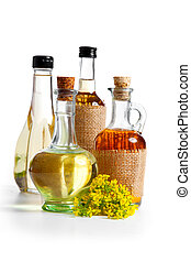 bottles of herbal and olive oil with rape flowers, isolated...