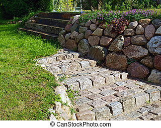 Garden stone walkway - Stone walkway path and stairs in a...