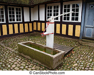Old well water pump - Old vintage well water pump in village...