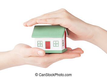 House safety - Little house toy in hands isolated over white...