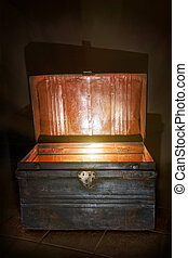 Old open chest glowing inside - Antique wooden chest with...
