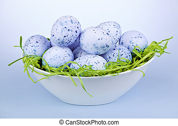 Blue Easter eggs in bowl - Many blue speckled easter eggs in...