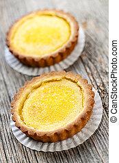 Lemon tarts - Two gourmet fresh lemon dessert tarts on...
