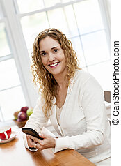 Smiling woman with smart phone - Portrait of smiling woman...