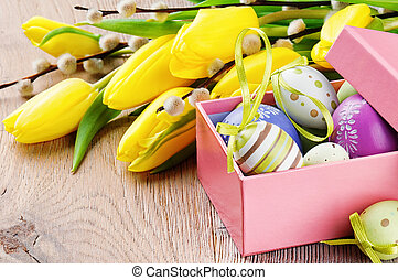 Colorful Easter eggs in open gift box