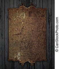 rusty plaque on a wooden texture