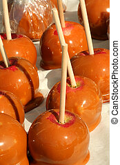 Bunch of carmel apples with sticks - A Bunch of carmel...
