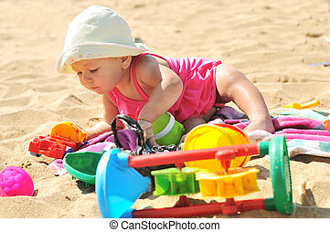 baby girl on the beach - baby girl playing on the beach