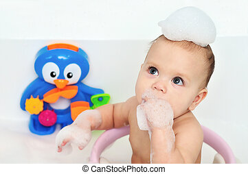 bathing baby - baby eating foam in big bath
