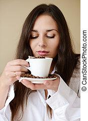 brunette enjoying smell of coffee - pretty brunette enjoying...