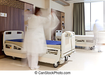 staff fixing bed hospital room