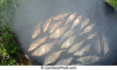fish smoking smoke rise - closeup ecologic natural organic...