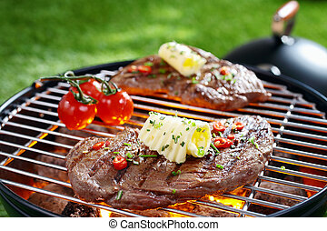 Succulent steak on a barbecue - Succulent portion of lean...