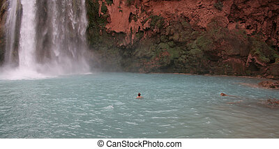 Man Beneath Havasu Falls - A man swimming beneath the Havasu...