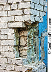 broken wall - detail of broken white brick wall with blue...