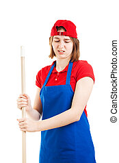 Disgusted Worker Mopping Up - Teenage worker makes a face of...