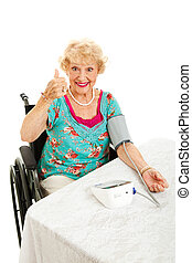 Thumbs Up for Low Blood Pressure - Pretty senior woman in...