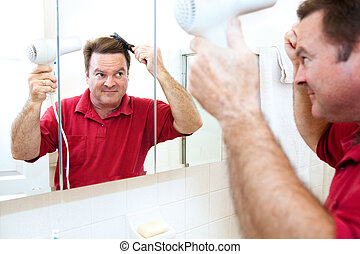 Drying Hair with Blow Dryer - Man drying his hair with a...