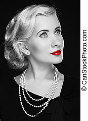 Retro woman with red lips. Black and white photo
