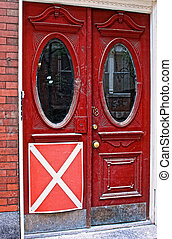 condemned sign posted on old red victorian doors in beacon...