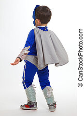 Young boy wearing a superhero suit - A Young Boy wearing a...