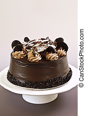 Chocolate cake - Round chocolate cake with frosting on a...