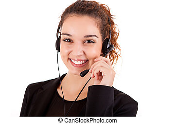 Portrait of a happy young call center employee smiling with...
