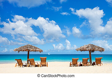 Chairs and umbrellas on tropical beach - Chairs and umbrella...