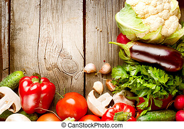 Healthy Organic Vegetables on a Wood Background