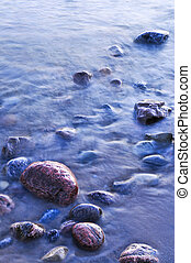 Rocks in water at the shore of Georgian Bay, Canada. Awenda...