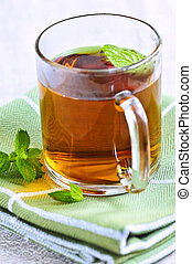 Mint tea - Cup of fresh herbal mint tea with peppermint...