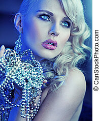 Stylish woman with hands full of pearls - Stylish blonde...